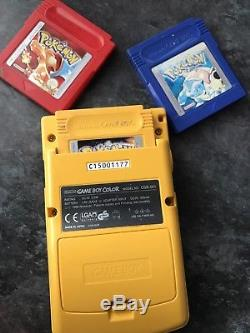Yellow Nintendo Game Boy Color with POKEMON Yellow, Red, Blue Version Pal